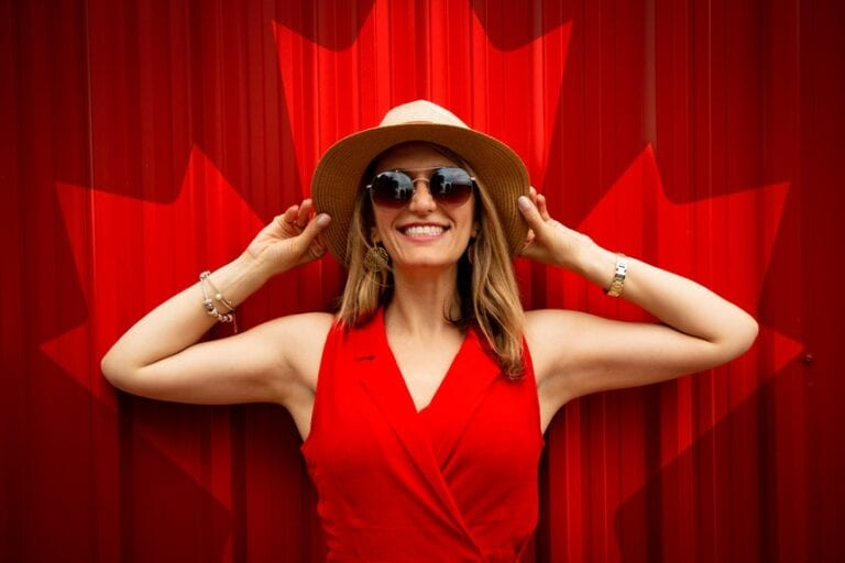 happy canadian woman granted a US work visa