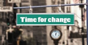 "A street sign saying it's ""time for change"", relating to famous career changes"