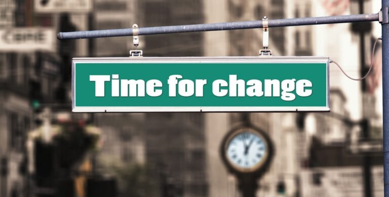"""A street sign saying it's """"time for change"""", relating to famous career changes"""