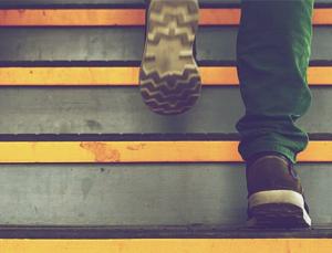 man climbing the career ladder to get job promotion