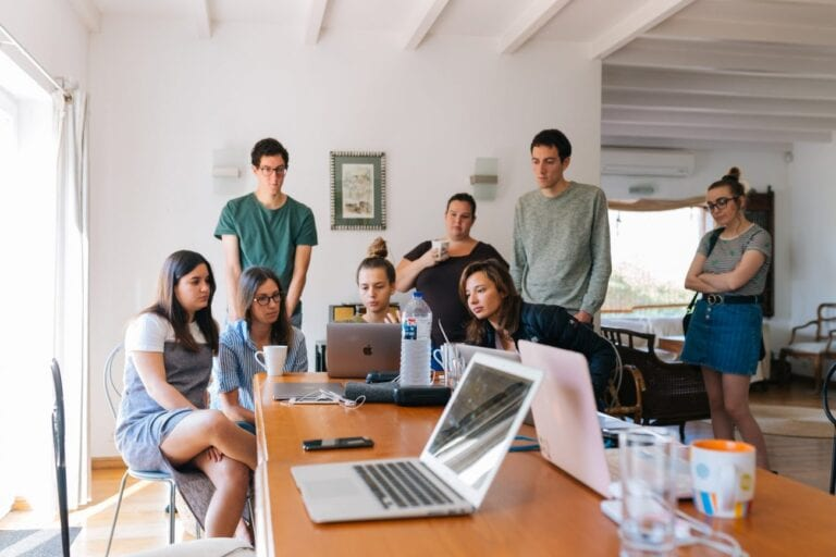 Workplace personalities vary in an office as signified by employees huddle for a meeting