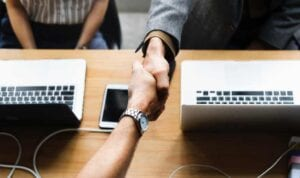 a professional hand shake to build rapport in job interview