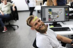 a happy working man representing work-life balance tips for employees