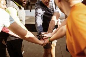 Huddling athletes with sports resume
