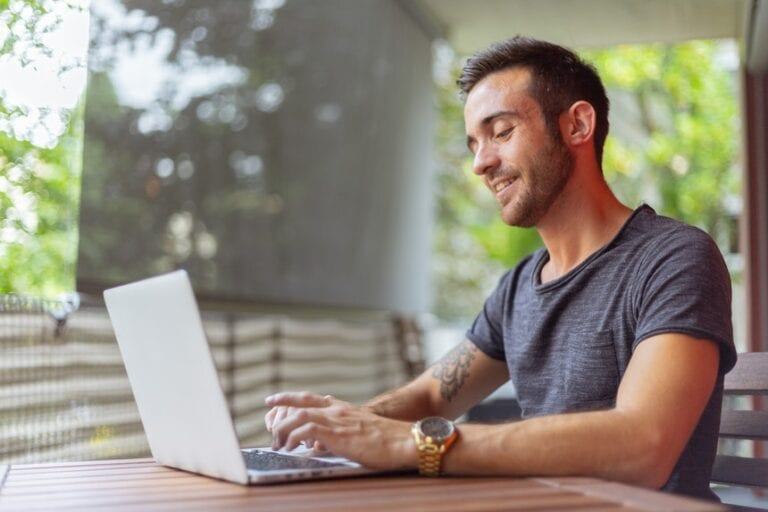 Man researching about applicant tracking system in his laptop