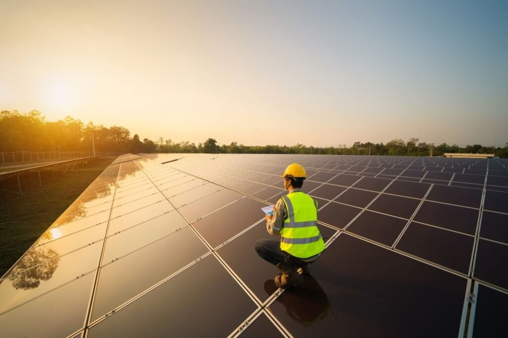 Engineer Working On Solar Panels On The Roof