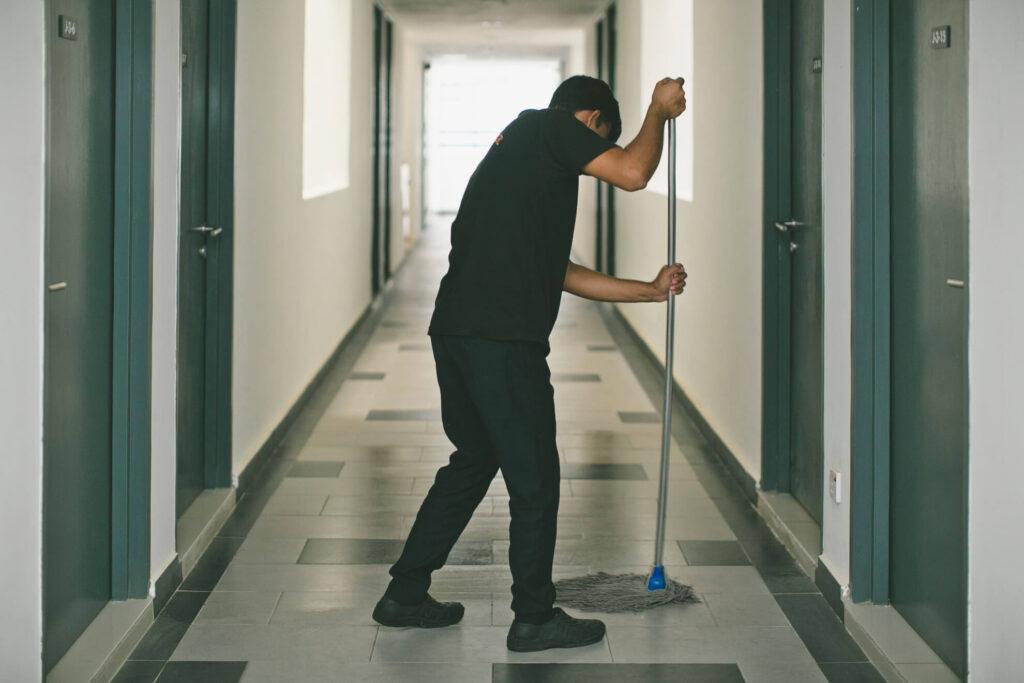 Housekeeper Cleaning The Floor