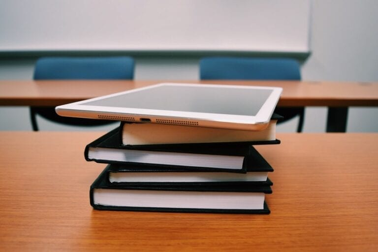 Tablet And Books Used In Research Intern Resume Examples