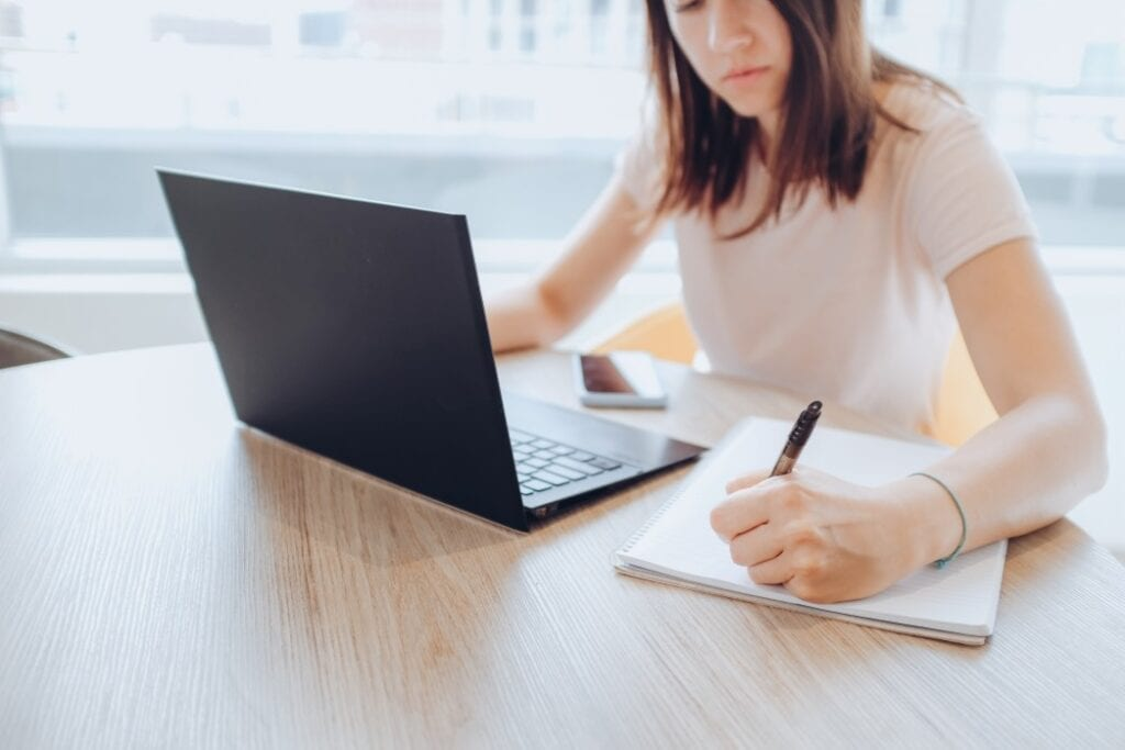 Woman Studying Online Course Using Her Laptop To Land A Job