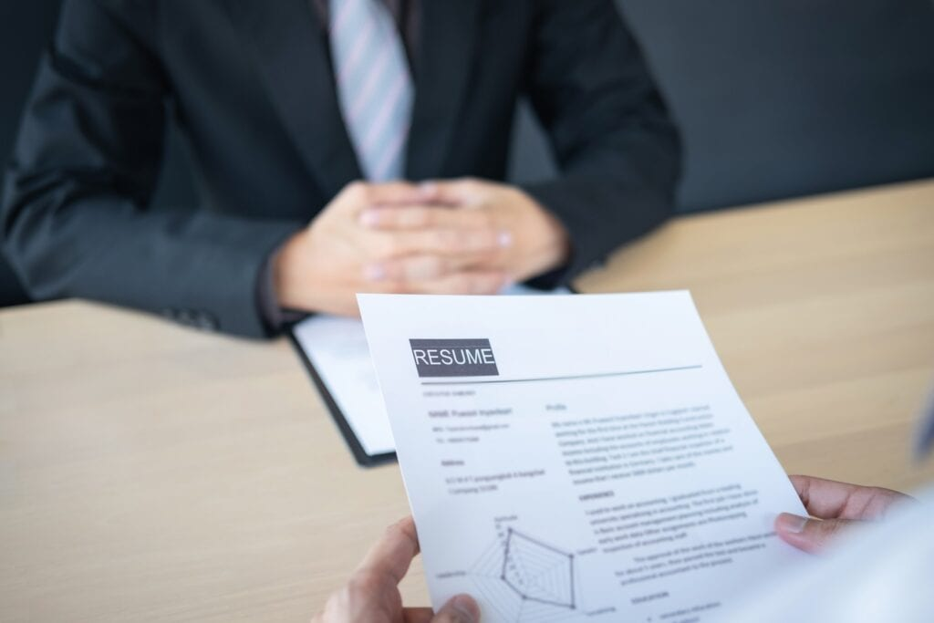 employer reading a resume during interview