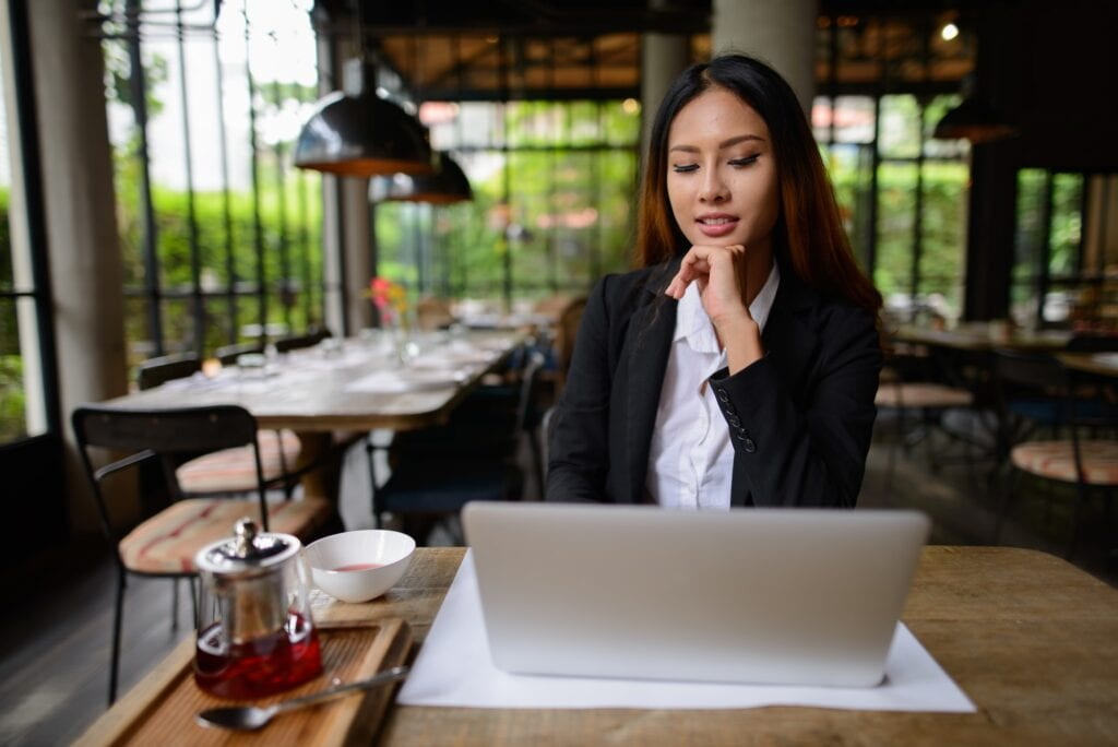 female job seeker about to take a free career quiz on her laptop