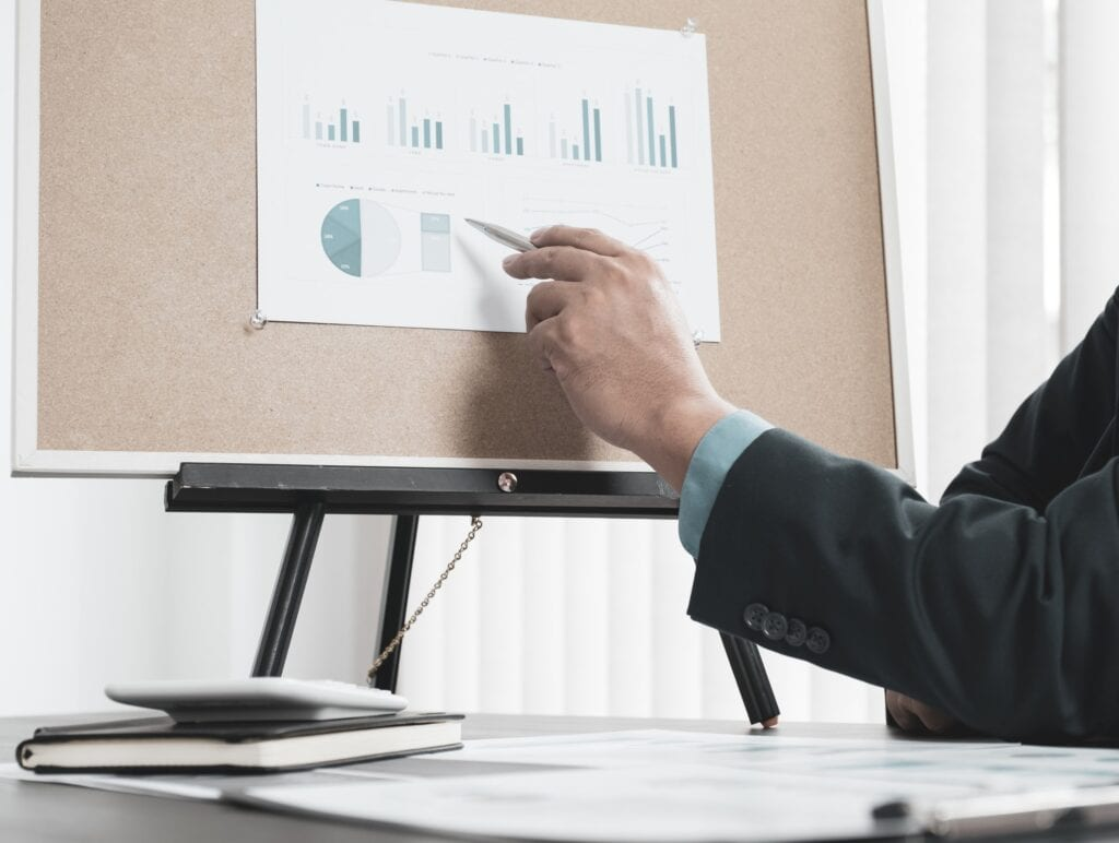 businessman analyzing the chart for setting business goals to achieve targets