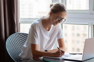 female working at home looking for free online certifications