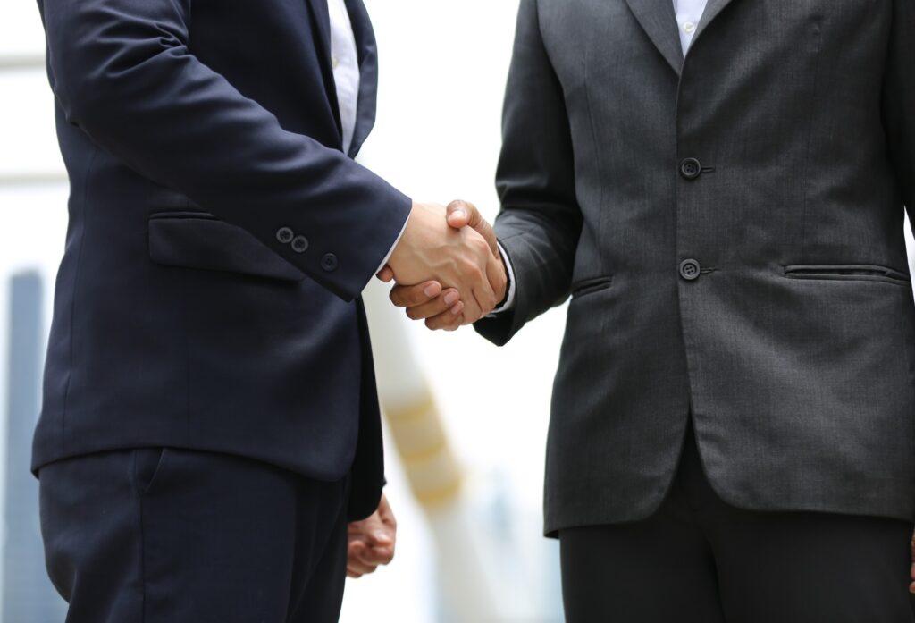 Handshake Of Two Men In Business Suits