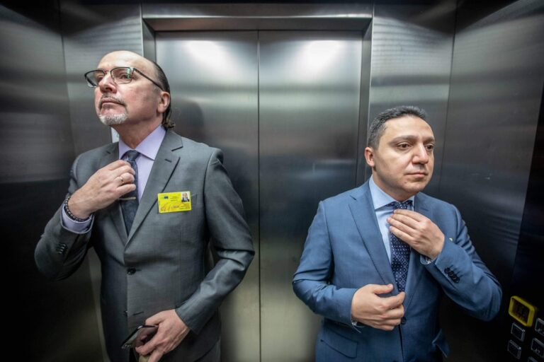 two people on the elevator