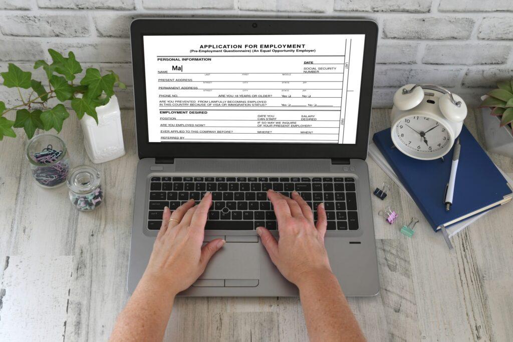 Female Job Seeker Filling Up Details On Her Federal Application