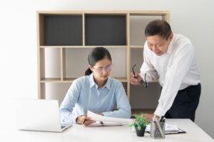 young intern mentored by company boss