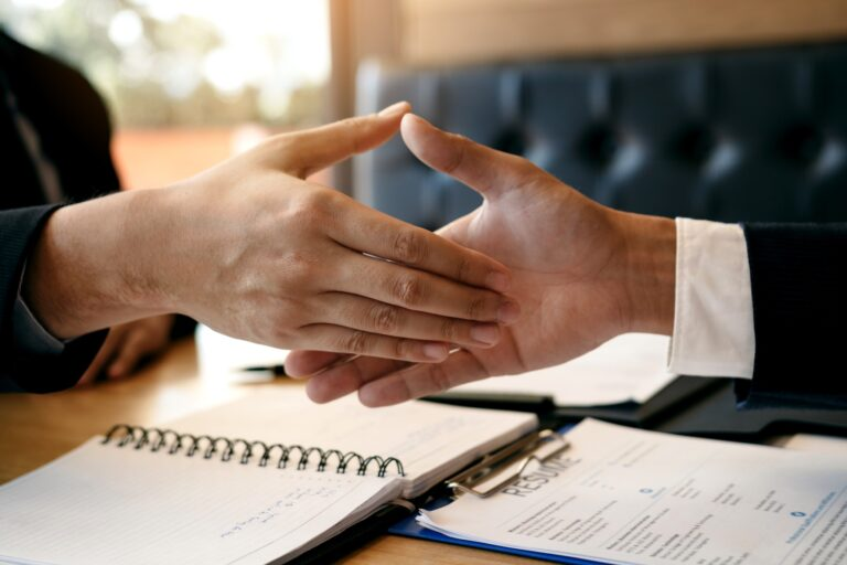 job seeker and interviewer shaking hands to signify job search success