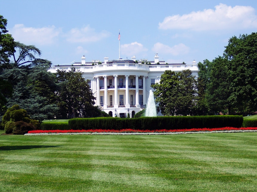 An image of the White House with trees along its side to represent the federal employment