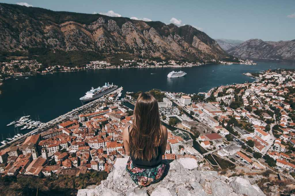 quarter-life crisis_Millennial girl overlooking a bay