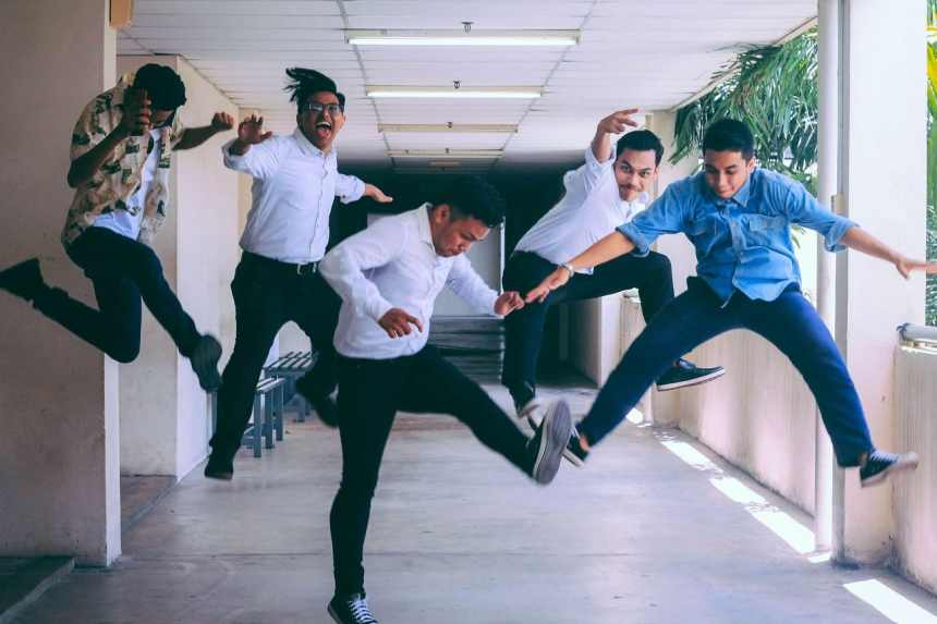 A group of millennials in a jumpshot signifying conquering the best resume writing services list of 2019 job search trends