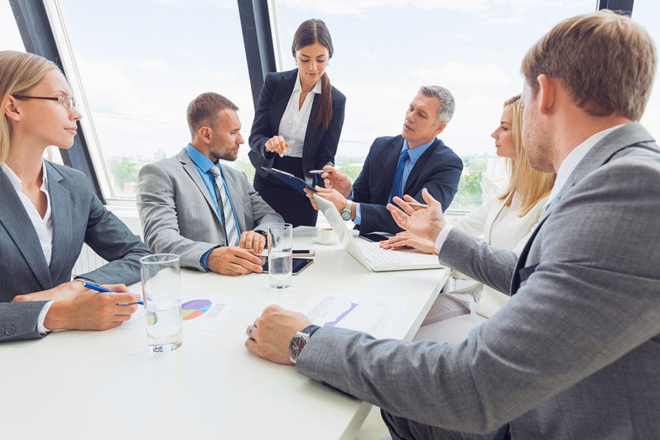 A group of professionals evaluating human resource director resumes, human resource director resume examples