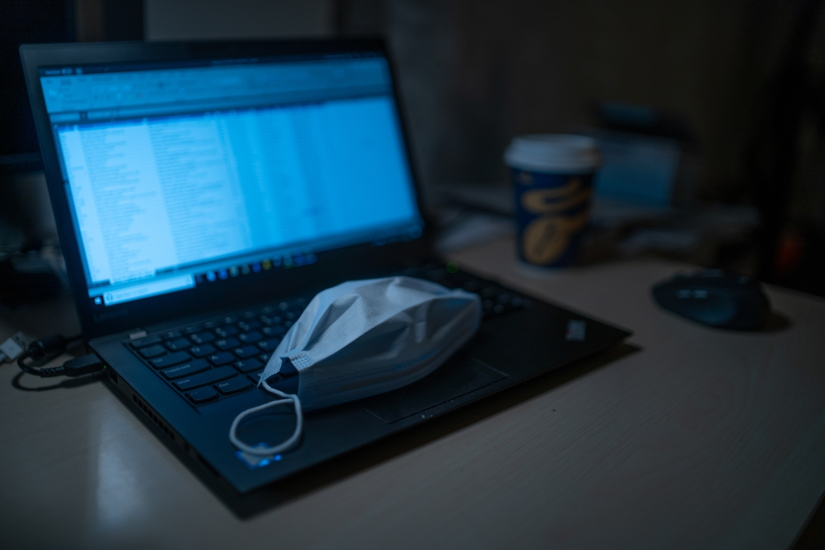 Surgical mask on open laptop